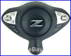 Genuine OEM Nissan 370z drivers steering wheel airbag with switches. 6E
