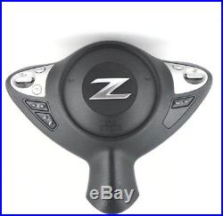 Genuine OEM Nissan 370z drivers steering wheel airbag with switches. SUPERB